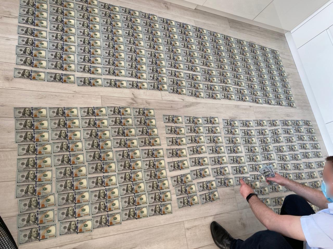 US 100 dollar bills on the ground