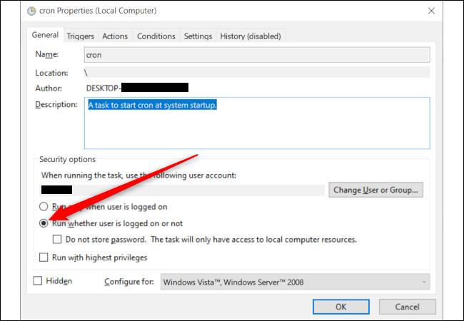 """Una ventana de propiedades de tareas de Windows con una flecha roja que apunta a la opción """"Ejecutar si el usuario está conectado o no."""""""