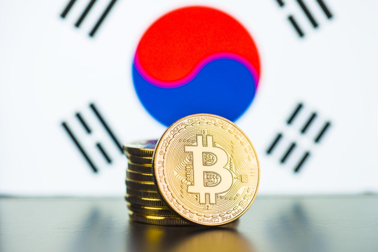 Golden bitcoins and South Korea flag