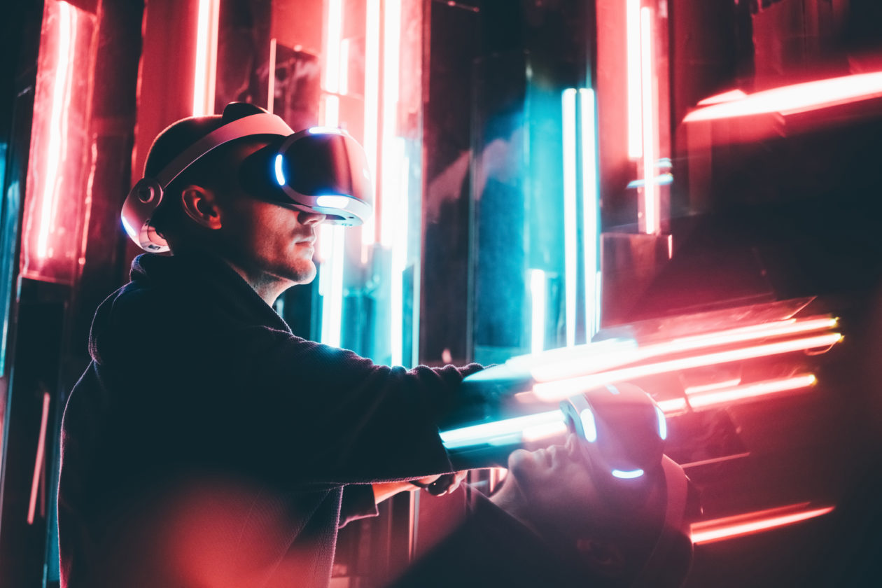 a man with vr device, China's largest brokerage said the metaverse would be popularized in two decades