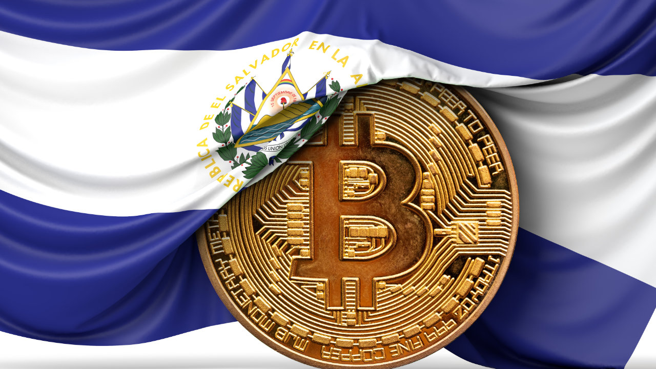 Picture of a gold bitcoin with El Salvador flag half draped over it