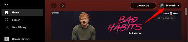 Haga clic en el nombre de usuario en la parte superior de Spotify en el escritorio.